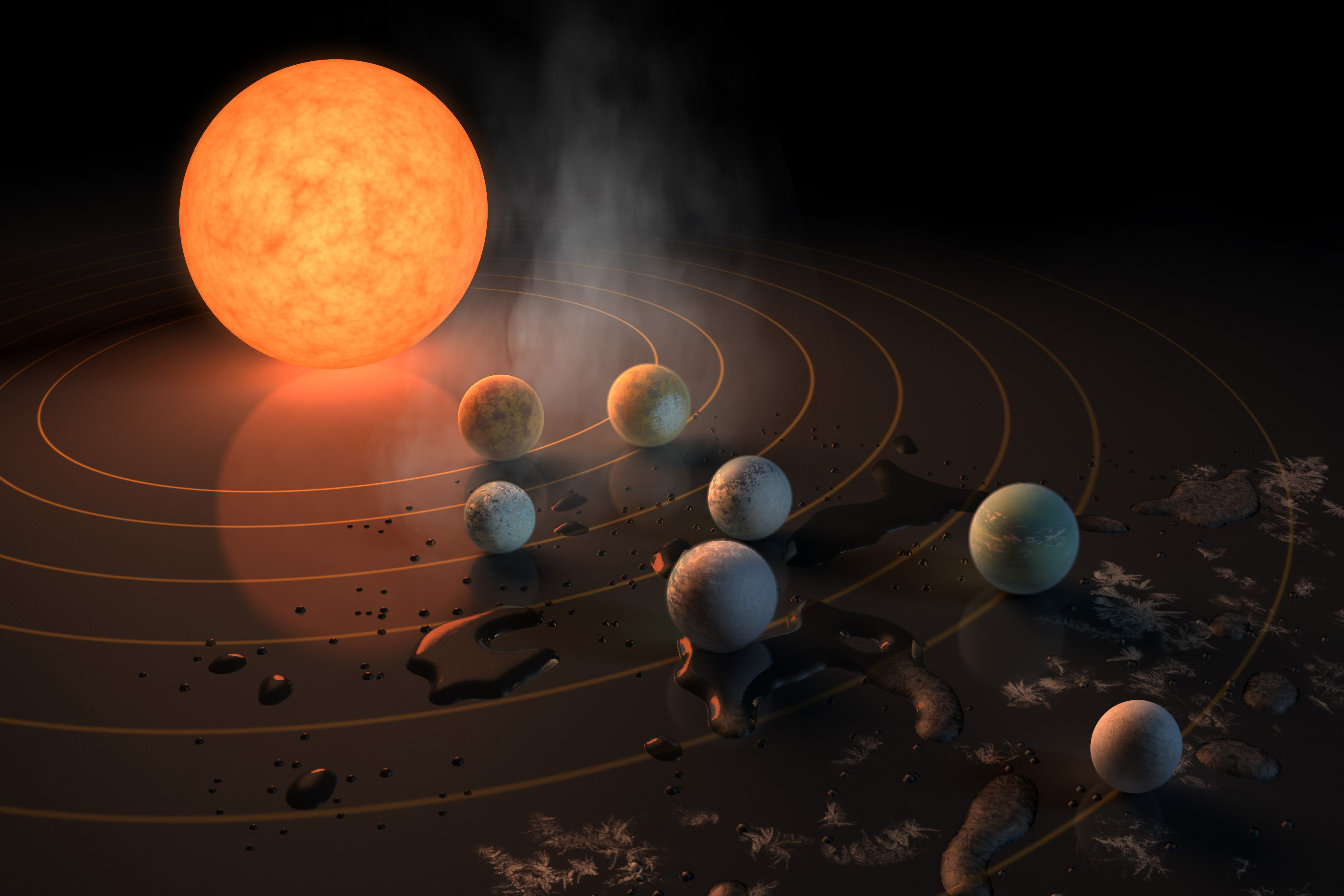 This artist's concept appeared on the Feb. 23, 2017 cover of the journal Nature announcing that the TRAPPIST-1 star, an ultra-cool dwarf, has seven Earth-size planets orbiting it. (NASA Image)