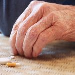 An elderly man taking his pills. (Getty Images)