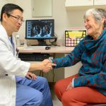 Dr. Juyong Lee, director of endovascular interventional medicine at UConn Health, left, with heart patient Barbara Graham. (Janine Gelineau/UConn Health Photo)