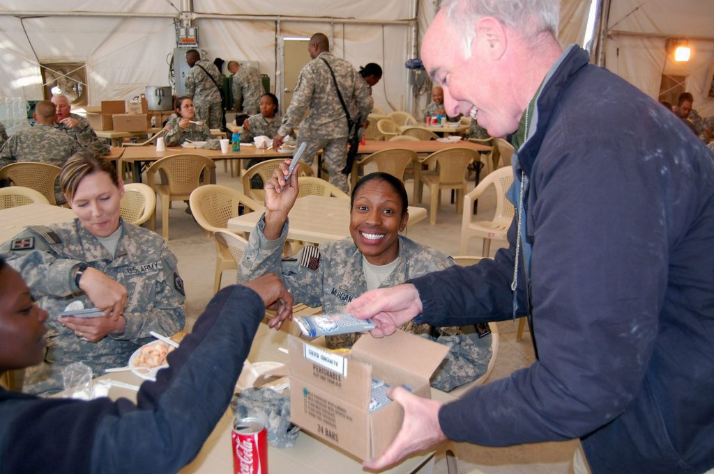 U.S. Rep. Joe Courtney (D-CT 2nd) '78 J.D. distributed UConn Husky chocolate bars, donated by Munsons Chocolates of Bolton, Conn., to U.S. military personnel during a trip to Iraq in December 2008. (Courtesy of Karen Munson)