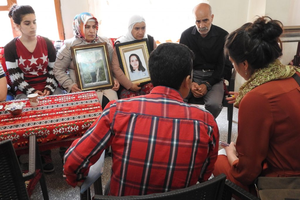 Physicians for Human Rights researcher Christine Mehta (far right) speaks with family members of people killed by Turkish security forces in the country's southeast. (Physicians for Human Rights Photo)