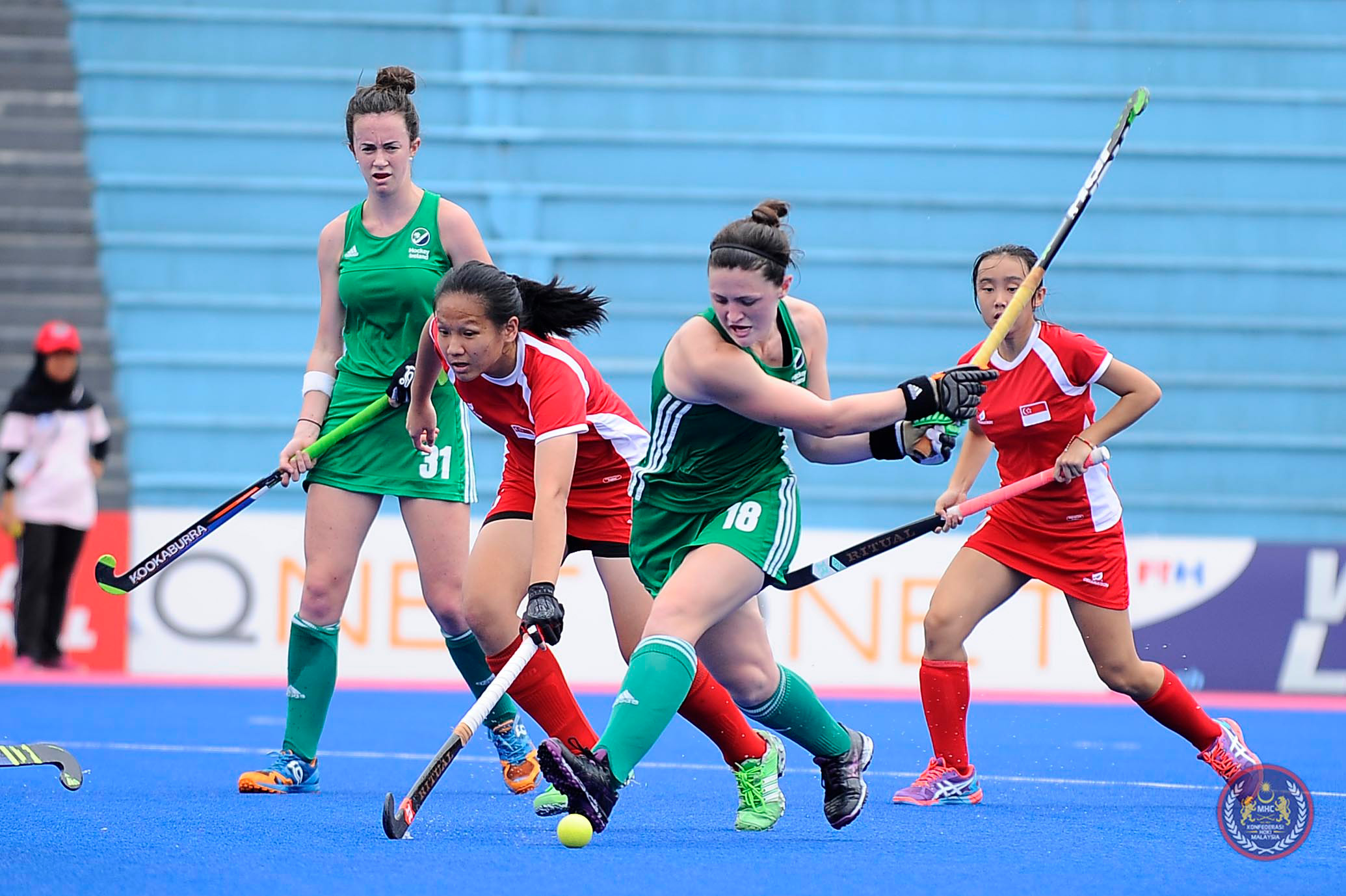 Former UConn standout Roisin Upton '16 (ED) swings at the ball during a game against Hong Kong in South Africa in January. Since graduating, Upton traded her UConn blue jersey for the green of the Irish National Team.