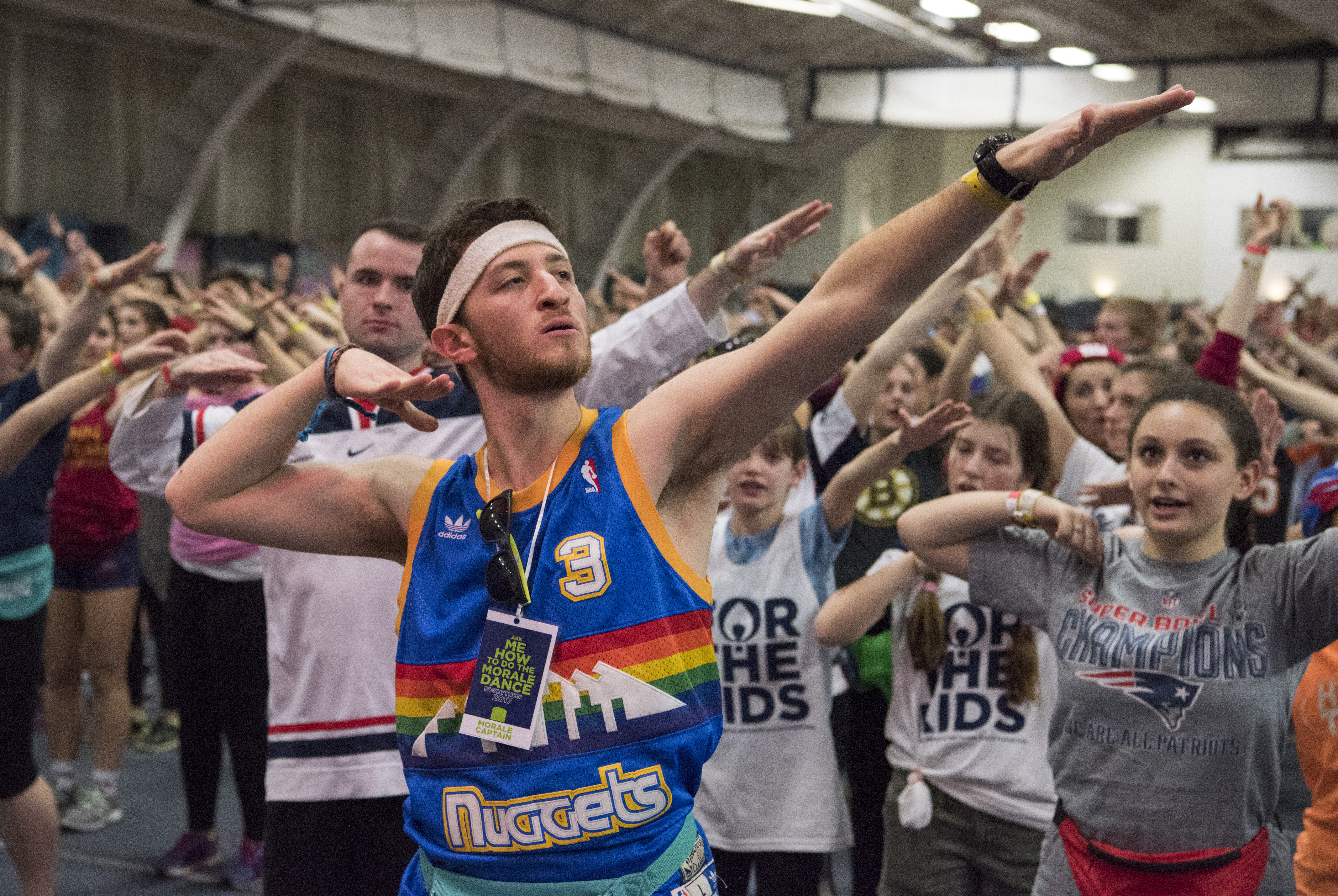 Nearly 2,000 students took part in the HuskyTHON dance marathon at the Greer Fieldhouse on Feb. 18, raising $836,174 for Connecticut Children's Medical Center. (Ryan Glista/UConn Photo)