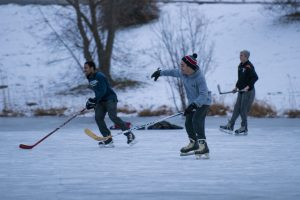 Students play ice hockey at Swan Lake on Feb. 2, 2017. (Ryan Glista/UConn Photo)