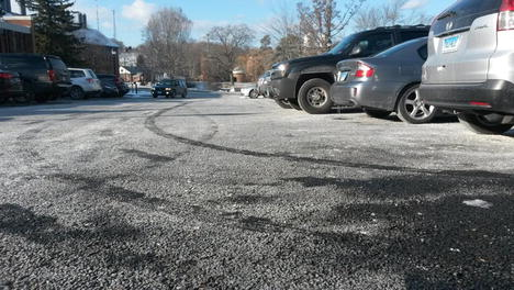 Deicing salt on the permeable pavement in front of Augustus Storrs Hall, a potential source of groundwater contamination causing mobilization of radium and radon.