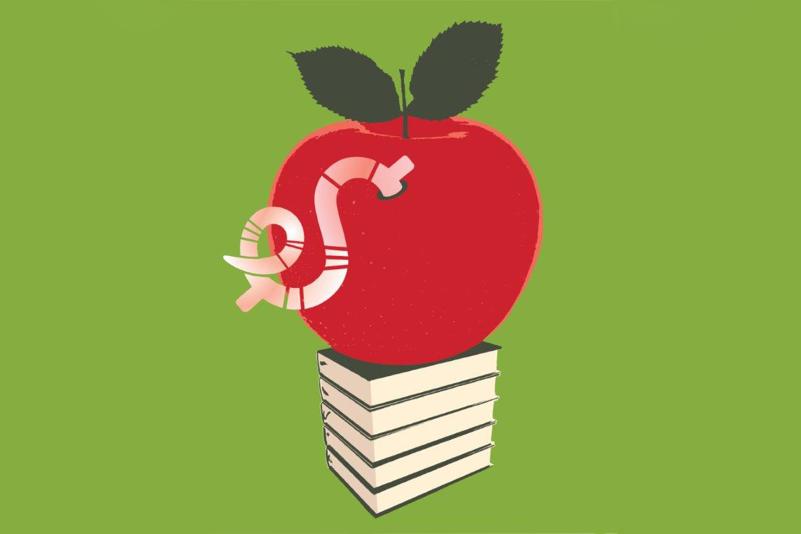 Apple with a dollar sign worm eating into it, on top of a pile of books. (Gillian Blease via Getty Images)
