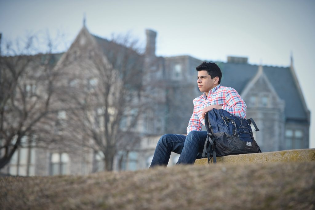 Mohammad Mansour, the youngest of six siblings to pursue undergraduate studies at the Avery Point campus, likes to end each day watching the sun set across Long Island Sound. (Peter Morenus/UConn Photo)
