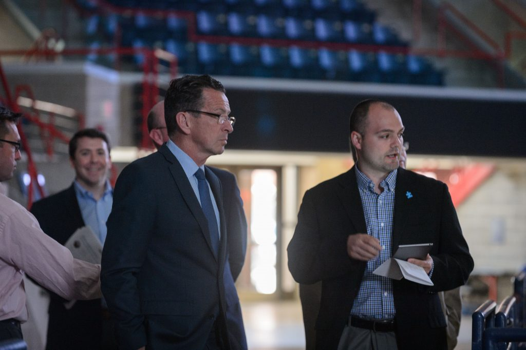 Anthony Rosati, facility manager, shows Gov. Dannel Malloy how the new energy saving lighting is controlled at Gampel Pavilion on April 18, 2017. (Peter Morenus/UConn Photo)