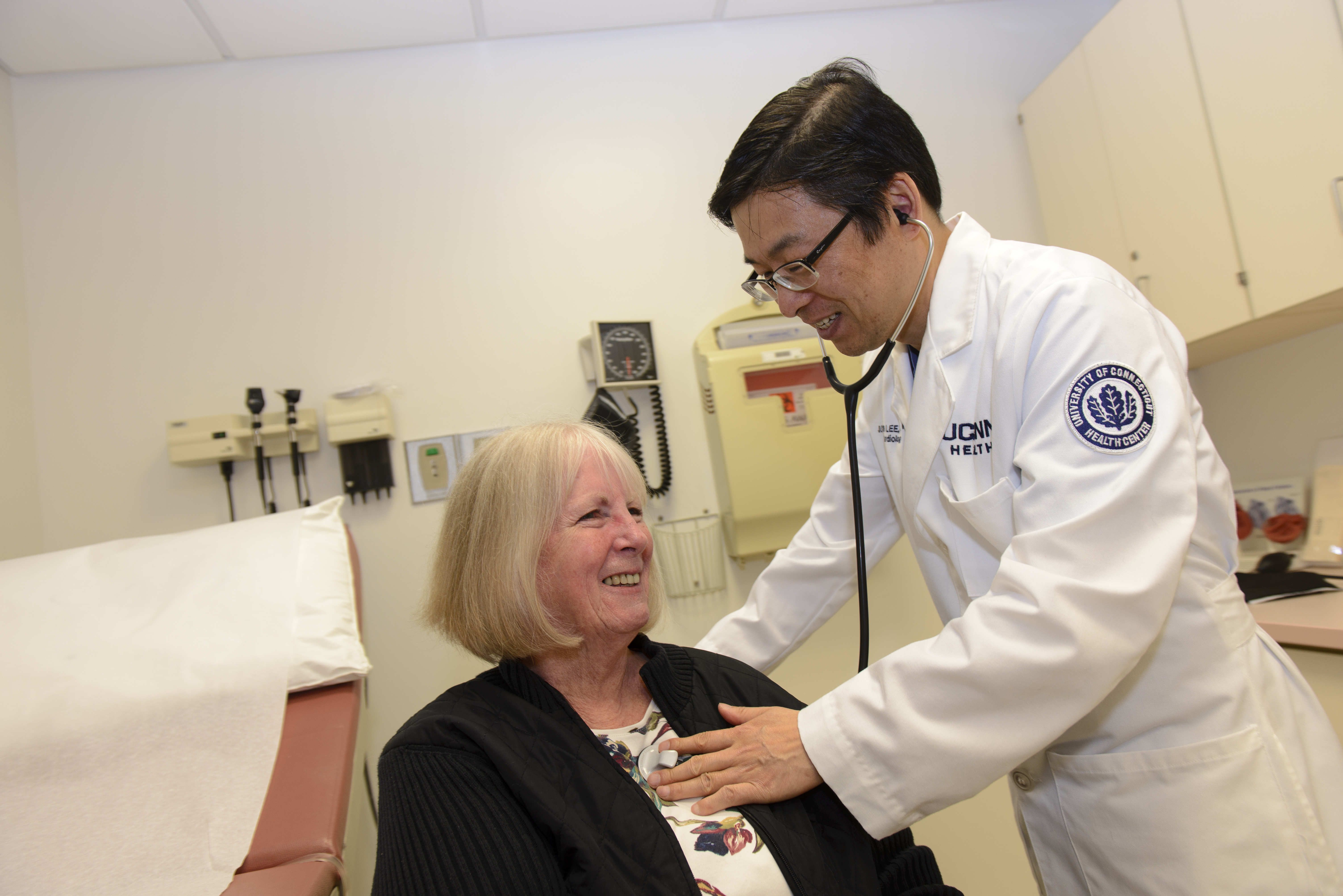 After her Fitbit alerted her to serious heart trouble, 73-year-old Patricia Lauder was successfully treated at UConn Health's Calhoun Cardiology Center by cardiologist Dr. JuYong Lee. (Janine Gelineau/UConn Health Photo)