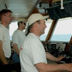 Dan Nelson, Captain of the RV Connecticut, with crew members Dan Nelson and David Cohen, navigate from the control room. (UConn File Photo)