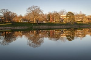 Reflection of South Campus on Mirror Lake on April 18, 2017. (Sean Flynn/UConn Photo)