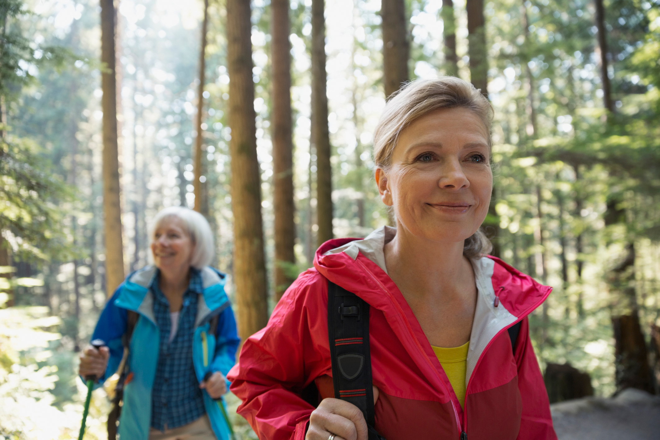 Two women walking in the woods. (Getty Images)