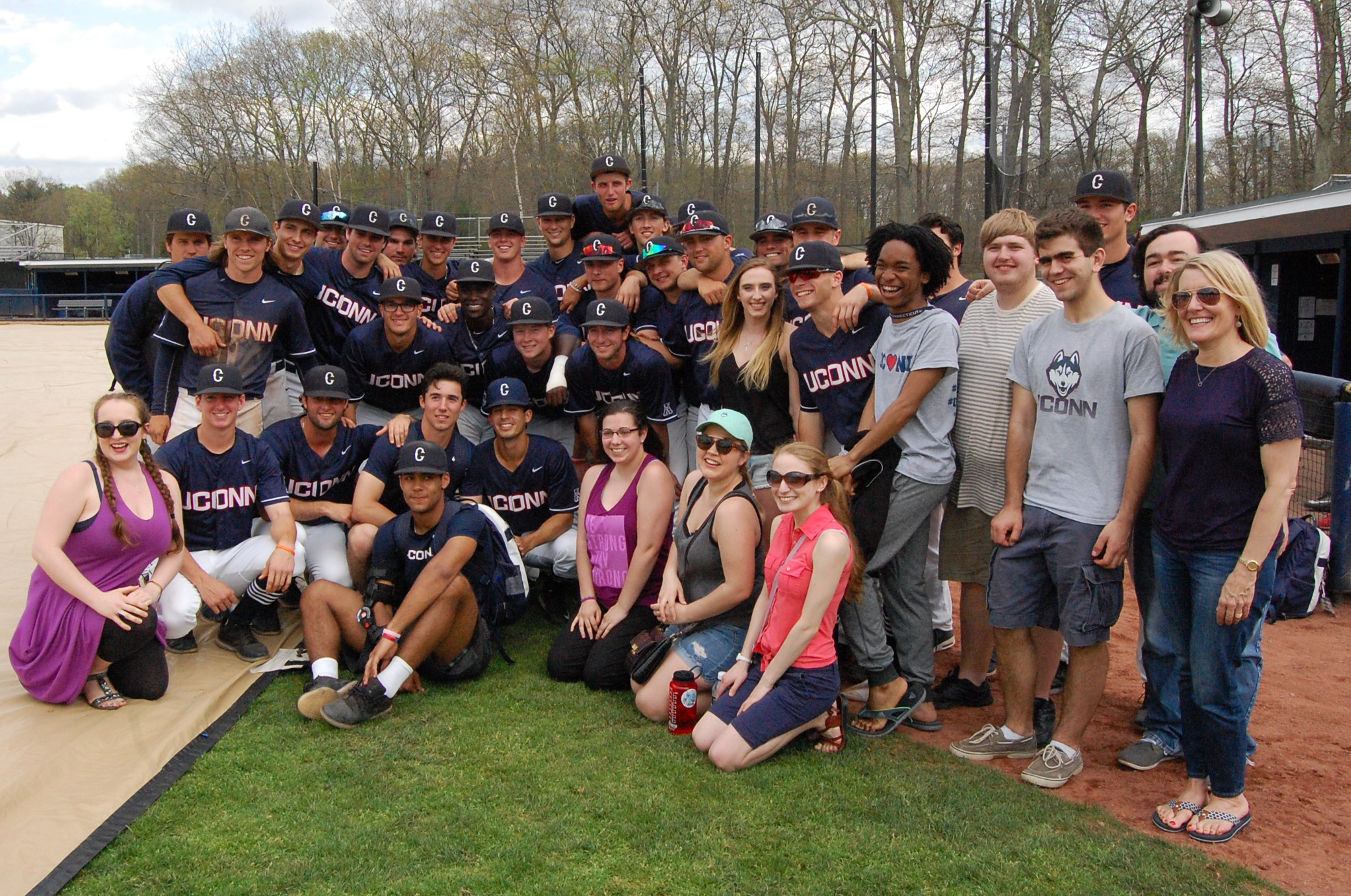 Music Students And The Baseball Team Gathered For A Team Photo On The Field  After The