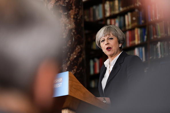 Theresa May, U.K. prime minister and leader of the Conservative Party, delivers a speech at the Royal United Services Institute (RUSI) in London, U.K., on Monday, June 5, 2017. U.K. opposition Labour leader Jeremy Corbyn traded blows with May over who has the worst record on countering terrorism, as Britains battle with jihadists looked set to dominate the final three days of the election campaign. Photographer: Chris Ratcliffe/Bloomberg via Getty Images