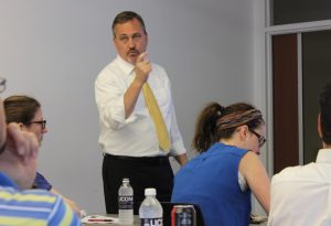Charles F. Caley, Clinical Professor of Pharmacy Practice, speaking to seminar attendees. (Sheila Foran/UConn Photo)