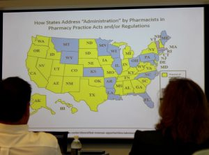 Rules and regulations for administration of drugs by pharmacists varies from state to state. (Sheila Foran/UConn Photo)