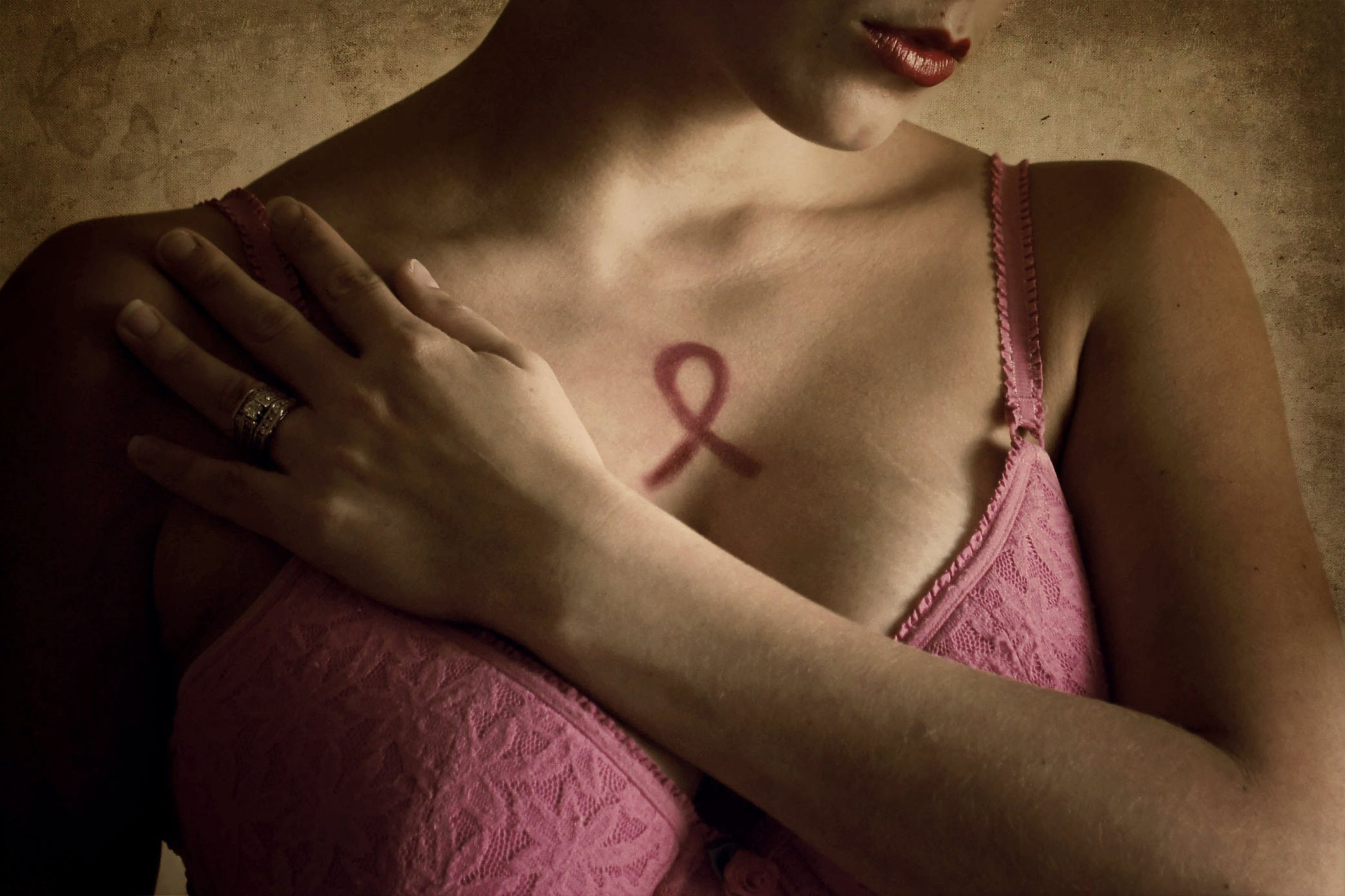 Woman in pink bra representing breast cancer awareness month. (Annette Bunch/Getty Images)