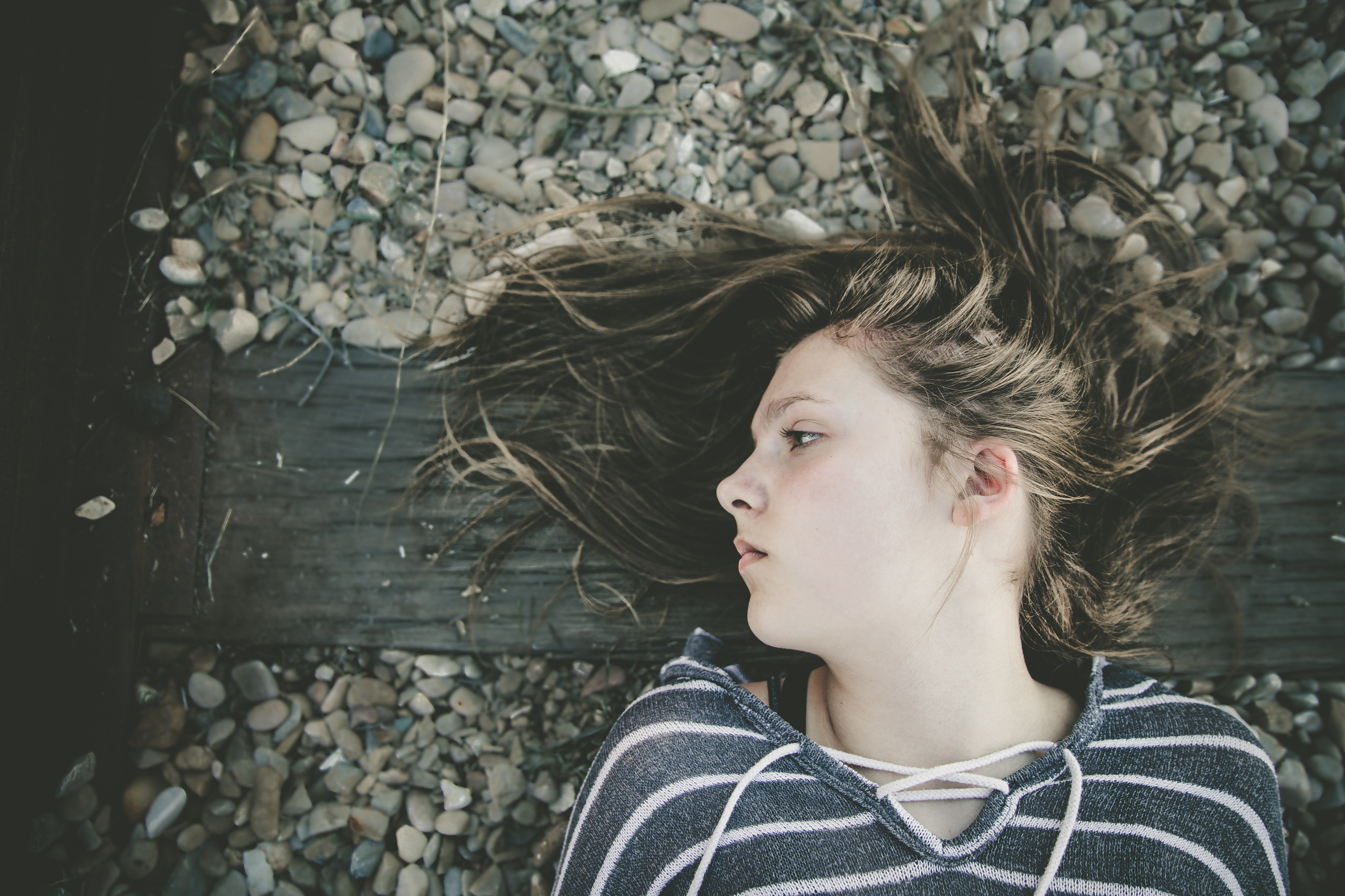 Young woman lying on railroad track. (Getty Images)