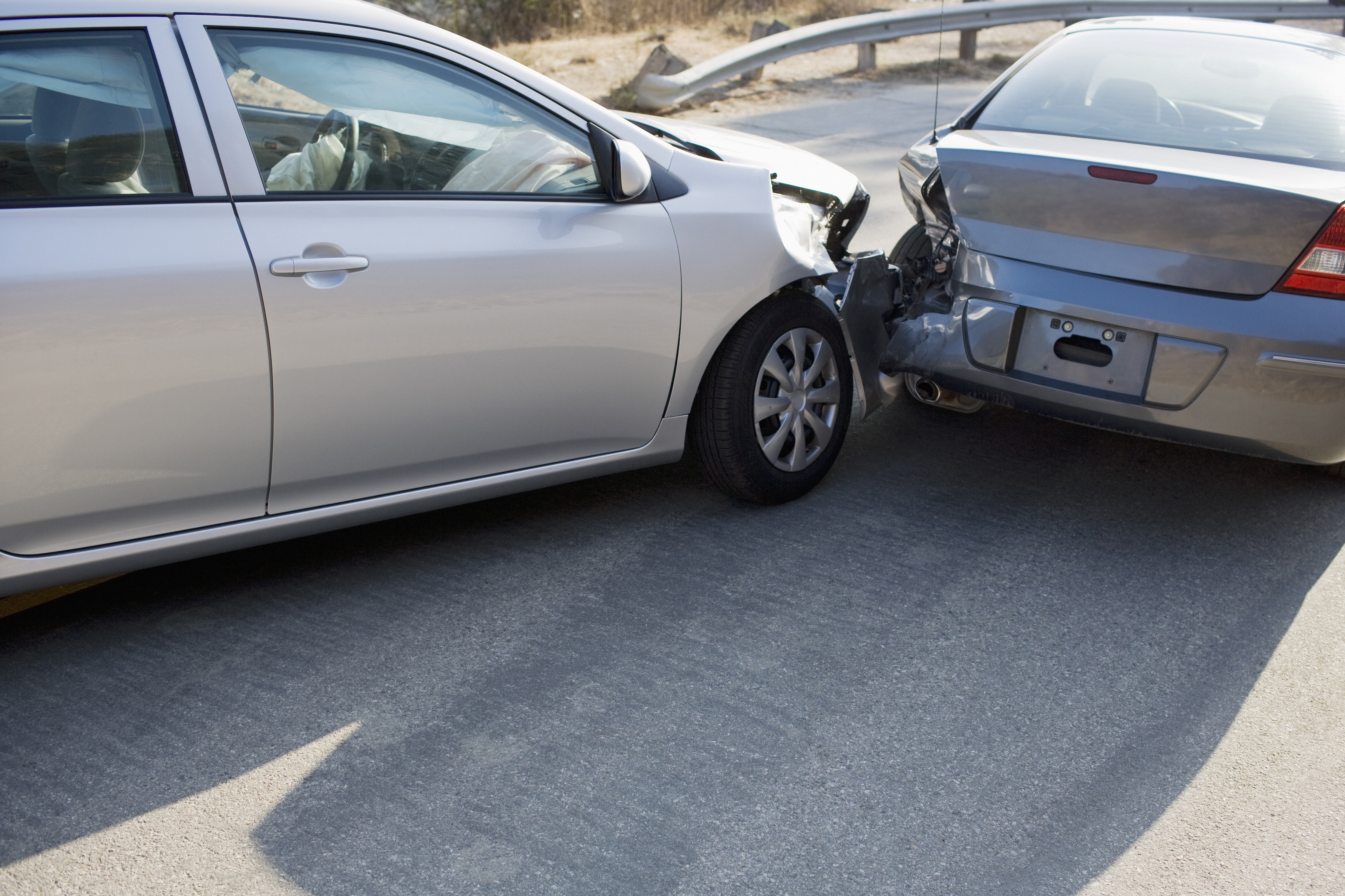 Two cars in collision on a roadway. (Getty Images)