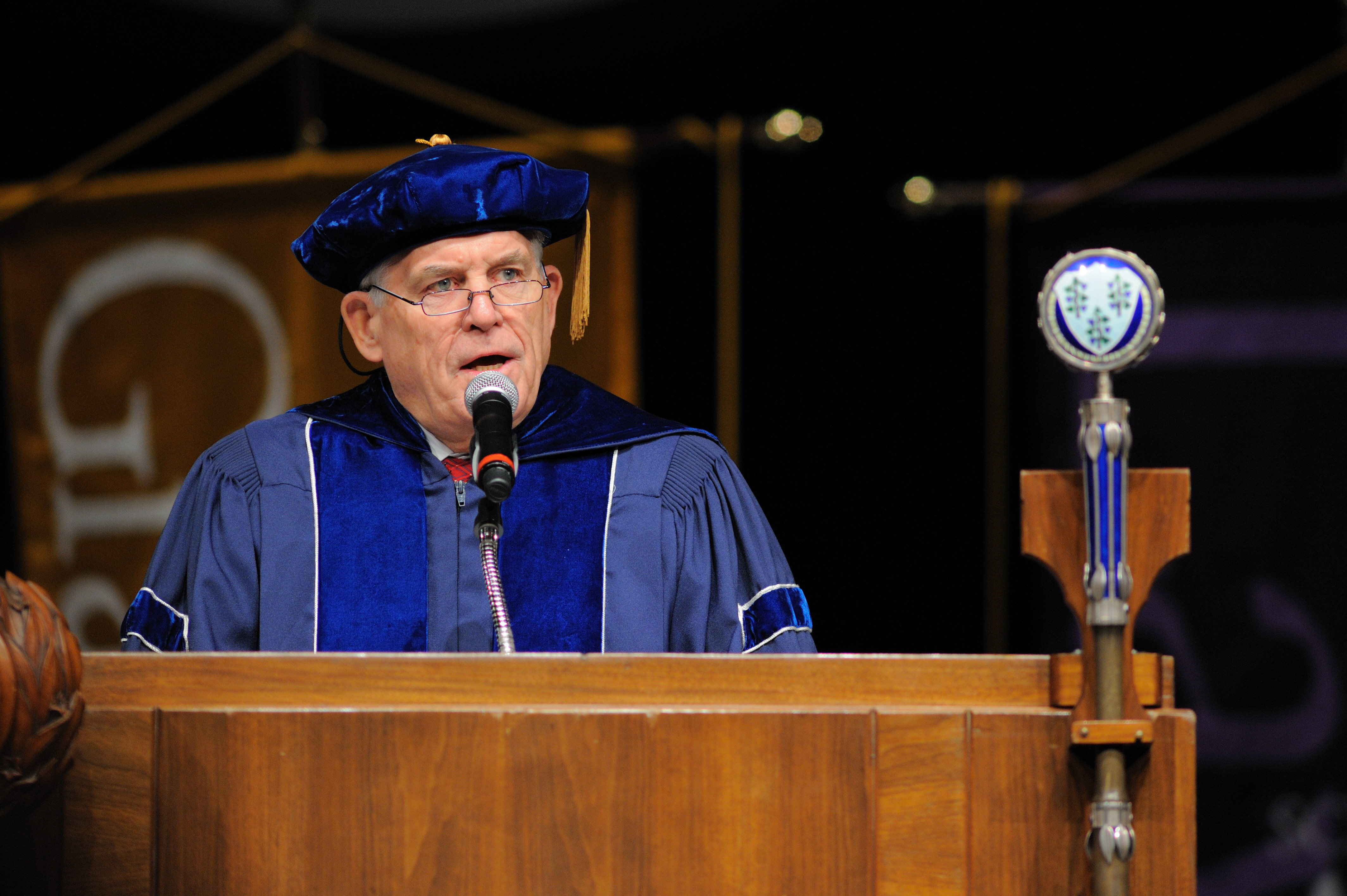 After eight years serving as chair of UConn's Board of Trustees during a period of growth and success, Larry McHugh will step down at the end of his current term. He will continue to serve, however, until Gov. Malloy nominates a successor. In this file photo, McHugh speaks at the inauguration ceremony for President Susan Herbst in September 2011. (Peter Morenus/UConn Photo)