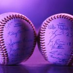 Two baseballs, one signed by the music students, the other by the baseball team. (Kenneth Best/UConn Photo)