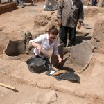UConn archaeologist Alexia Smith works in the field.