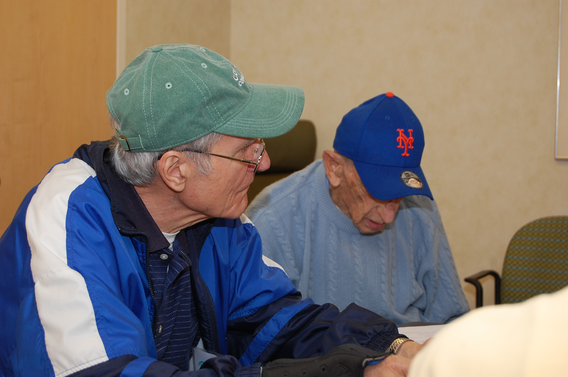 Two of the participants in the Baseball Reminiscence Program at River House Adult Care Center in Cos Cobb, Connecticut. (Kenneth Best/UConn Photo)