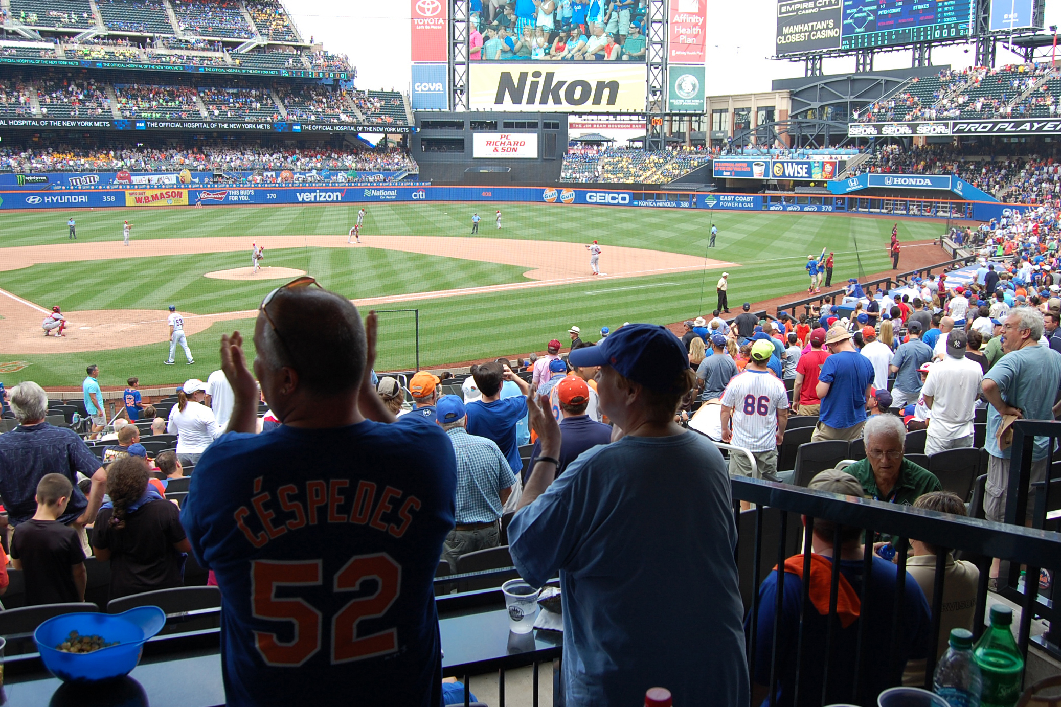 A Participant In The River House Baseball Reminiscence Program And Her Son Cheer On Mets