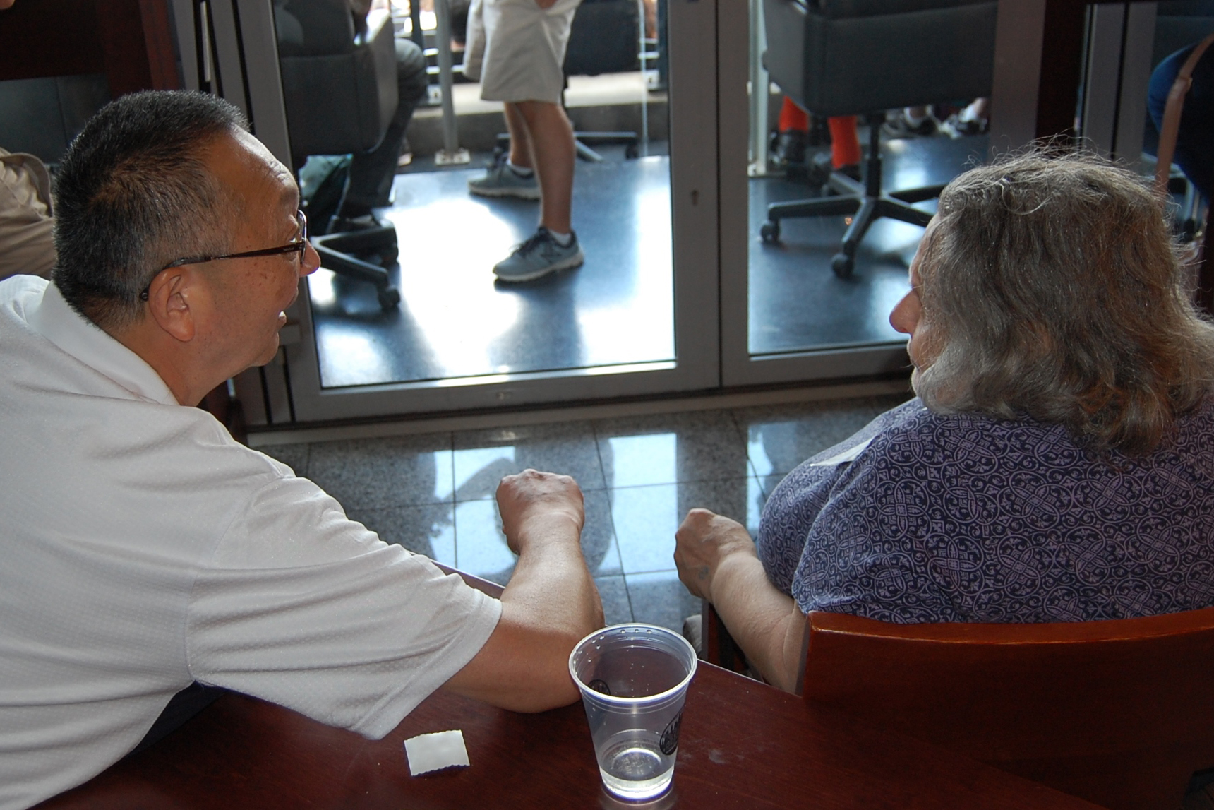 Michael Ego, professor of human development and family studies at UConn's Stamford campus, with a client in the Baseball Reminiscence Program at River House Adult Care Center in Cos Cobb, Connecticut, during a trip to Citi Field in New York City for a Mets game. (Kenneth Best/UConn Photo)