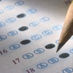 A close up of a multiple choice test with a pencil. (Getty Images)