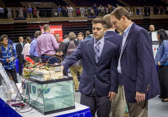 Discovery Day will give students the opportunity to network with Navy professionals. In this photo, a student explains his design project to an industry professional at UConn's 2016 Senior Design Day, (Chris LaRosa/UConn Photo)