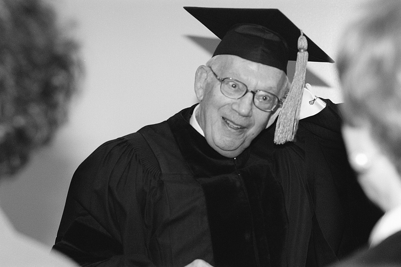 Dr. Raymond Sackler preparing for the 1998 commencement ceremony, where he received an honorary degree. (Richard Boynton/UConn File Photo)