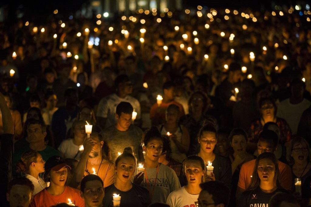 Thousands gather with candles to march along the path that White Supremacists took the prior Friday with torches on the University of Virginia Campus in Charlottesville, United States on August 16, 2017. (Photo by Samuel Corum/Anadolu Agency/Getty Images)