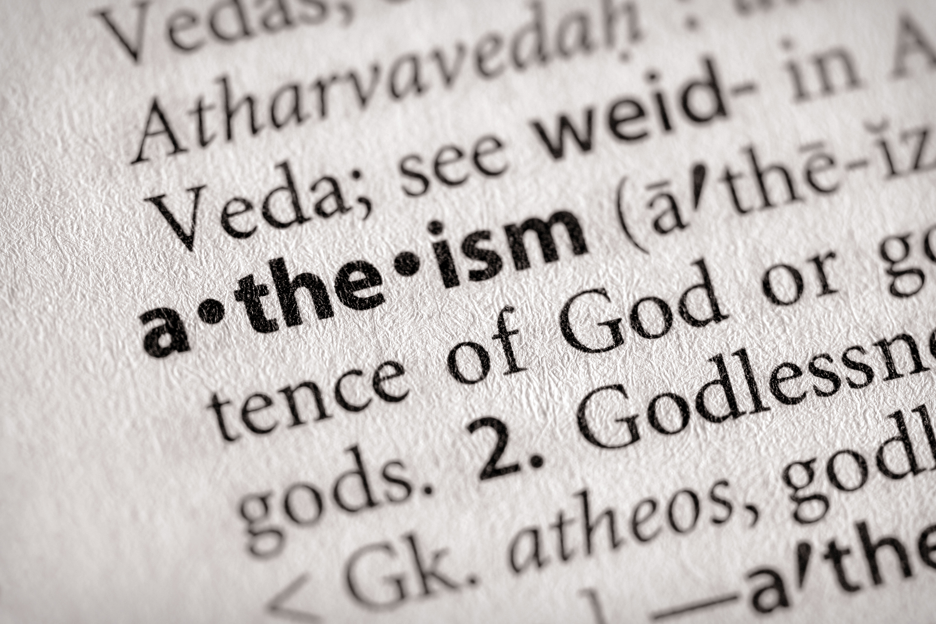 Page of a dictionary, with focus on the word 'atheism.' (Getty Images)