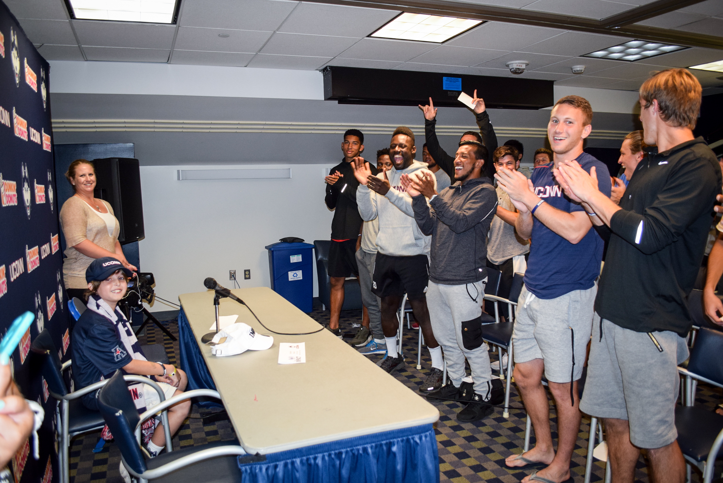 Maddox Bruening, a 13-year-old from South Glastonbury, Connecticut, was introduced as the newest member of the Husky team at a press conference that included his parents, Joey and Sherry, as well as the UConn coaching staff and team.