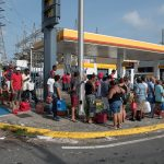 Crowds of people wait in line for gas at a Shell station in San Juan Puerto Rico on Sept. 26, 2017 after Hurricane Maria struck the island six days prior. International Medical Corps is in Puerto Rico to assess the damage and help those suffering in the wake of the storm. (Photo by Ken Cedeno, IMC)