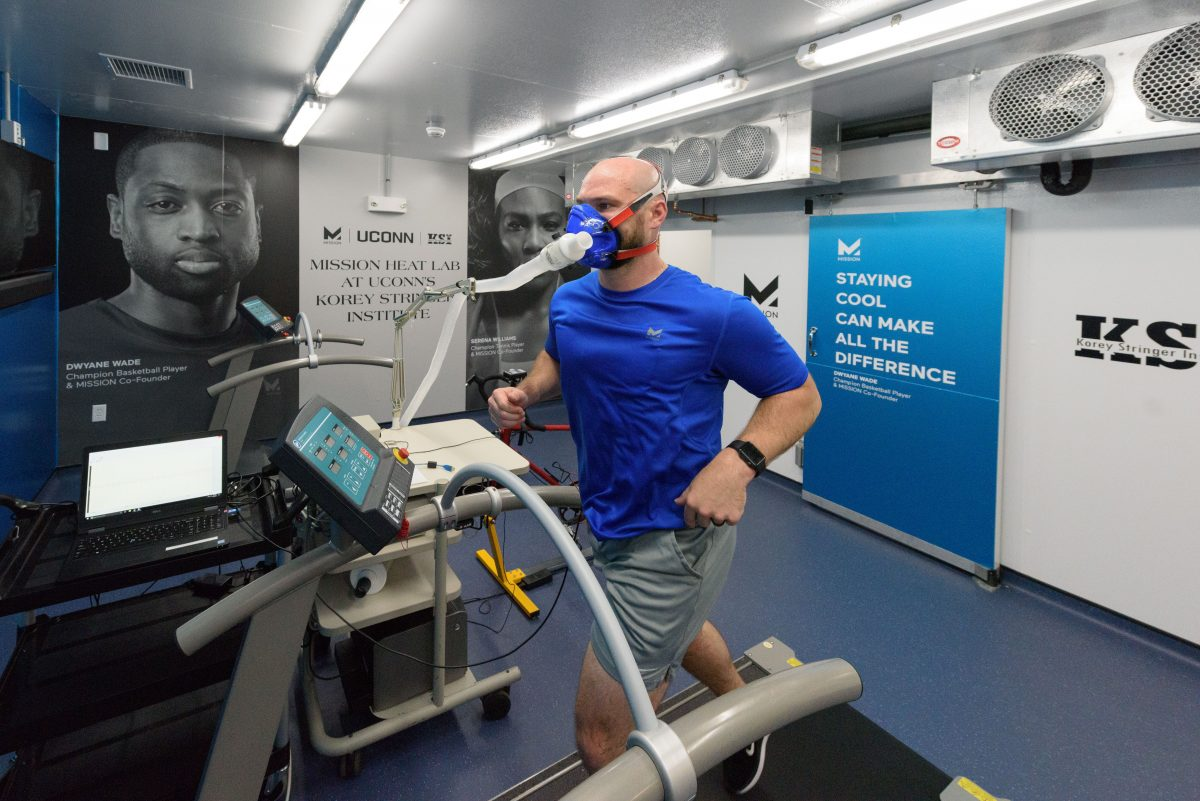 Ryan Curtis, KSI associate director of athlete performance and safety, runs on a treadmill at the Mission Heat Lab at the Korey Stringer Institute at Gampel Pavilion on Sept. 21, 2017. (Peter Morenus/UConn Photo)