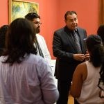 """John Quiñones, an ABC news correspondent and host of """"What Would You Do?"""" speaks with student leaders at the Jorgensen gallery on Sept. 19, 2017. (Peter Morenus/UConn Photo)"""