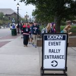 A line of students, faculty, and staff members snakes around the block in front of the Hugh S. Greer Field House. (Peter Morenus/UConn Photo)