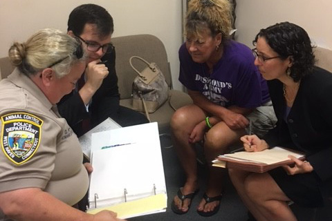 Professor Jessica Rubin, right, discusses a case with, from left, West Haven Animal Control Officer Denise Ford, law student Christopher Kelly, and Desmond's Army co-founder Christine Kiernan.