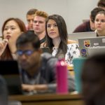 Irma Valverde '18 (CLAS, BUS) listens to a lecture by Professor Anna Radziwillowicz in the School of Business. (Sean Flynn/UConn Photo)
