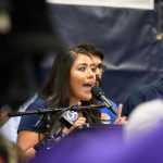 Undergraduate Student Government President Irma Valverde '18 (BUS)(CLAS) speaks during a rally at the Hugh S. Greer Field House on Sept. 20, 2017. (Peter Morenus/UConn Photo)
