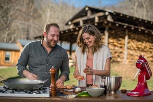 In Asheville, North Carolina, Joel Gamoran and local celebrity chef Katie Button put together an outdoor dinner feast, using out-of-the-box local ingredients consisting of food that usually gets trashed. The pair gather discarded spent grain from a local craft brewery to make incredibly savory biscuits, as well as using caul fat, adding intense flavor to chorizo.
