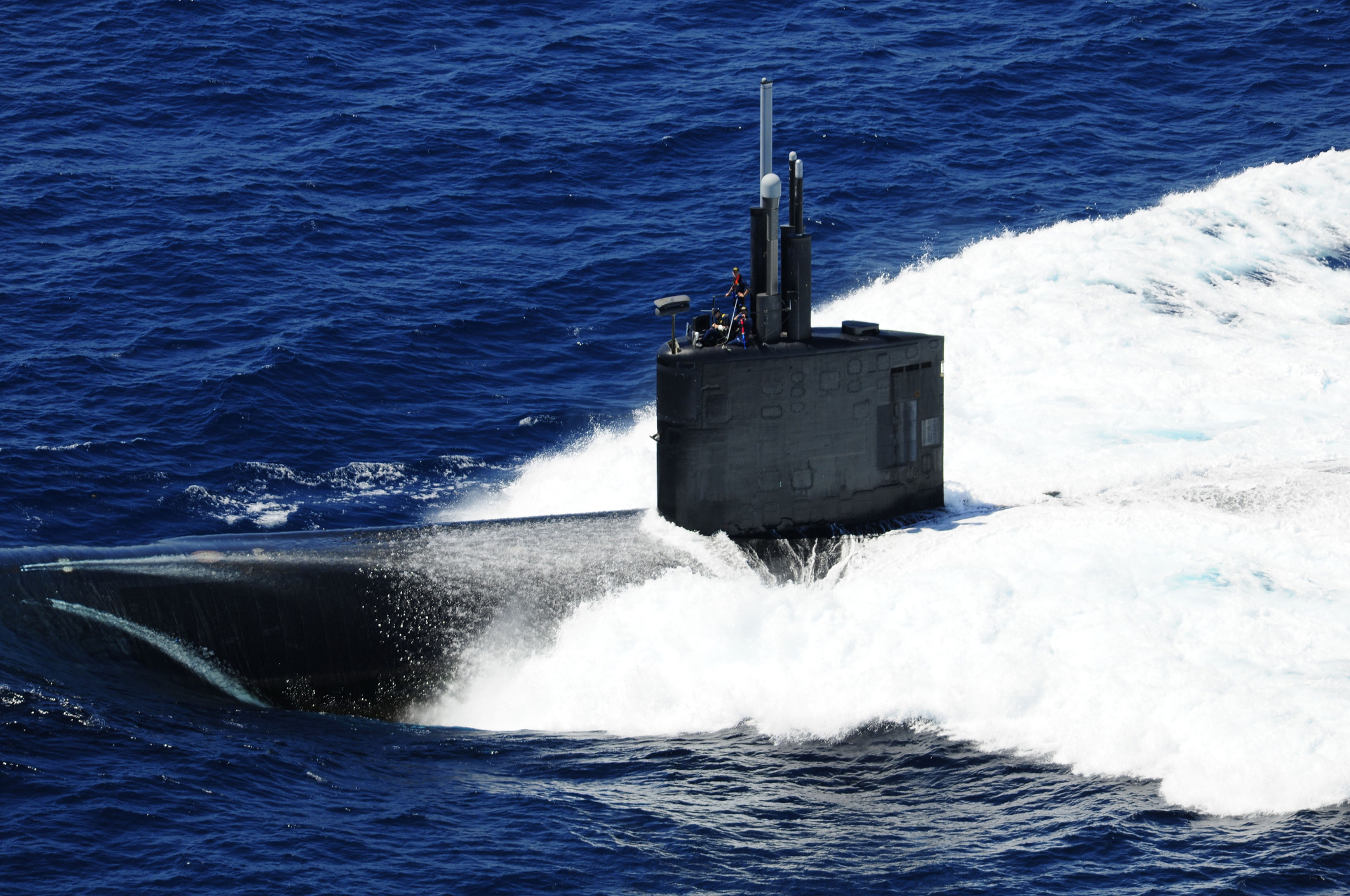 Atlantic Ocean. The fast-attack submarine USS Alexandria (SSN 757) surfaces for a formation sailing event while participating in the War of 1812 fleet exercise.