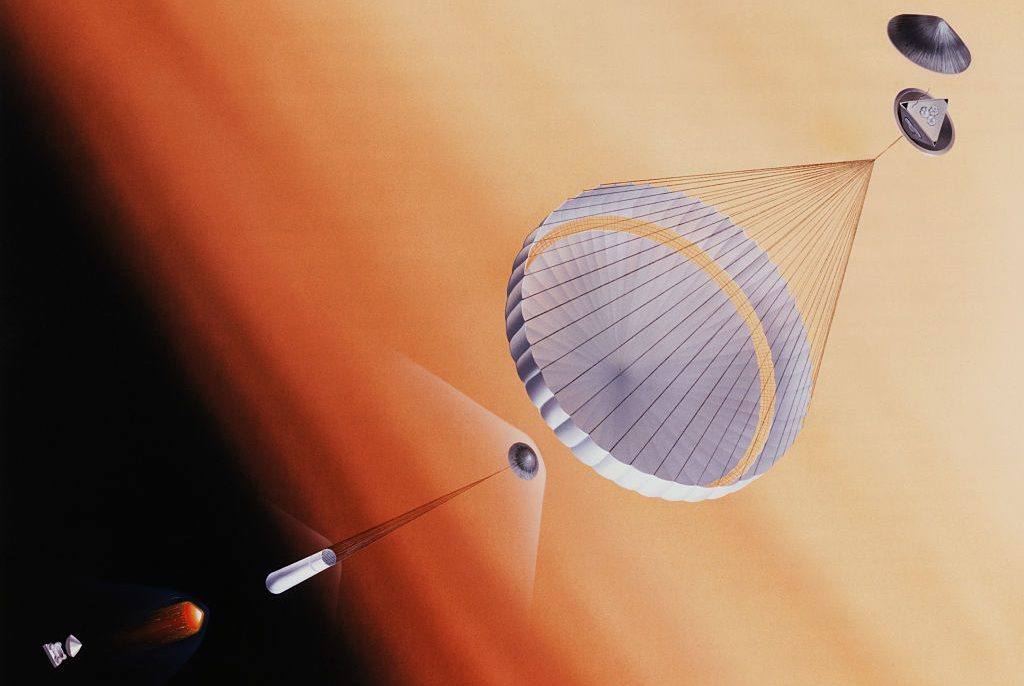 Artist's rendition of the descent of the Pathfinder lander onto planet Mars. The lander will descend by parachute, and will be protected by airbags which will deflate upon impact. The three petals protecting the lander will open after it lands. In this rendition the petals are partially opened. (Photo by © CORBIS/Corbis via Getty Images)