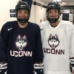 Freshmen Morgan, left, a forward, and Taylor Wabick, a defender, at the Freitas Ice Forum. 'We have always been on the same team, except for one game,' says Taylor. (Steve Lewis/UConn Photo)