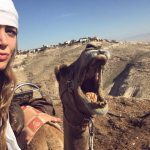 Among her many travels, Olivia Balsinger '14 CLAS) has hobnobbed with camels in the Masada Desert in Israel. (Photo courtesy of Olivia Balsinger)