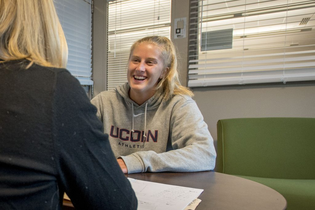 Student-athlete Heidi Druehl, Women's Soccer, speaks with her academic counselor Ingrid Hohmann about an upcoming exam she will need to take while traveling with the team. (Sean Flynn/UConn Photo)