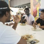2 p.m. Socializing over lunch at Putnam Dining Hall. (Sean Flynn/UConn Photo)