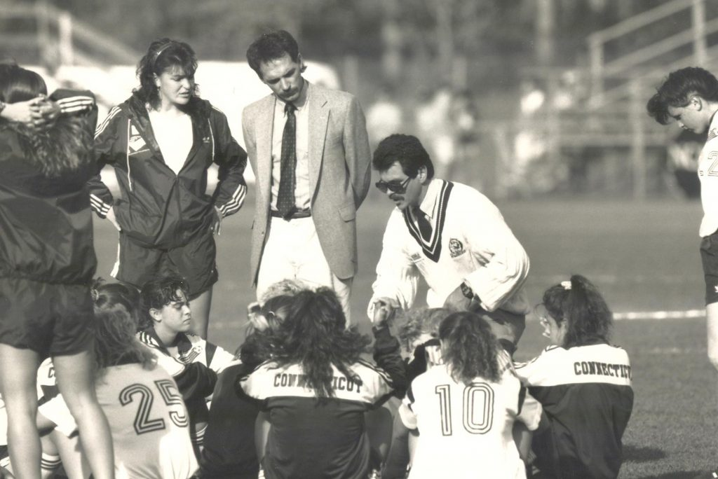 Women's Soccer Coach Len Tsantiris talks to the team in 1984.
